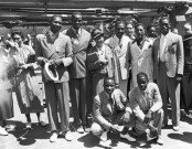 15 Jun 1936 --- Original caption: 6/15/1936-New York, New York- These are the Olympic athletes who will do their stint for Uncle Sam in the big games in Berlin. Left to right rear: Dave Albritton, ans Cornelius Johnson, record high jumpers; Tidye Pickett, woman track star; Ralph Metcalfe, sprinter; Jim Clark boxer and Matthew Robinson, sprinter. In front are John Terry (left) weight lifter and John Brooks, Broadjumper. --- Image by © Bettmann/CORBIS
